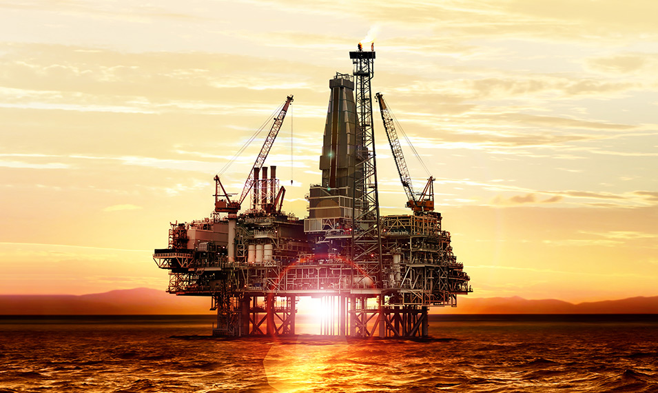 Project Management - Sun setting behind an oil rig